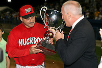 September 15 2008:  Mark DeJohn of the Batavia Muckdogs, Class-A affiliate of the St. Louis Cardinals, accepts the trophy from Ben Hayes after winning the NY-Penn League championship after a game at Dwyer Stadium in Batavia, NY.  Photo by:  Mike Janes/Four Seam Images