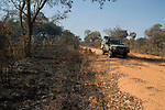 Panthera research vehicle and burned miombo woodland, Kafue National Park, Zambia