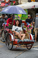 George Town, Penang, Malaysia.  Trishaw with Passenger.