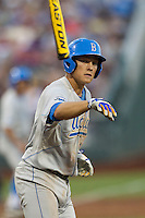 UCLA shortstop Pat Valaika (10) tosses his bat after drawing a walk against the North Carolina State Wolfpack during Game 8 of the 2013 Men's College World Series on June 18, 2013 at TD Ameritrade Park in Omaha, Nebraska. The Bruins defeated the Wolfpack 2-1, eliminating North Carolina State from the tournament. (Andrew Woolley/Four Seam Images)
