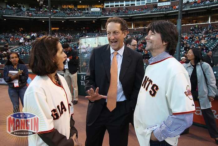 SAN FRANCISCO - SEPTEMBER 14:  Filmmakers Ken Burns and Lynn Novick, co-directors of 'The Tenth Inning', PBS's newest production, talk with San Francisco Giants jerseys by San Francisco Giants chief operating officer Larry Baer before the game between the Los Angeles Dodgers and San Francisco Giants at AT&T Park on September 14, 2010 in San Francisco, California. Photo by Brad Mangin