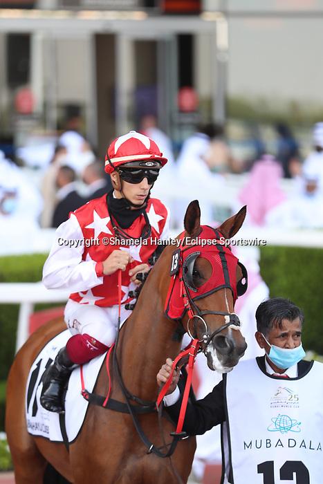 March 27 2021: RB MONEY TO BURN #13, in the post parade for the Dubai Kahayla Classic at Meydan Racecourse, Dubai, UAE. Shamela Hanley/Eclipse Sportswire/CSM