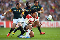 Keita Inagaki of Japan passes the ball. Rugby World Cup Pool B match between South Africa and Japan on September 19, 2015 at the Brighton Community Stadium in Brighton, England. Photo by: Patrick Khachfe / Stewart Communications