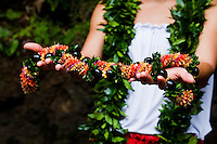 A woman's hands holding a cigar lei