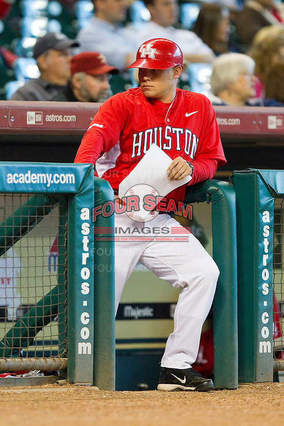 Houston Cougars coach Steven Trout #23 in the visitors dugout during the game against the Kentucky Wildcats at Minute Maid Park on March 5, 2011 in Houston, Texas.  Photo by Brian Westerholt / Four Seam Images