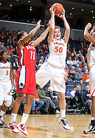 Dec. 6, 2010; Charlottesville, VA, USA;  Virginia Cavaliers forward Chelsea Shine (50) grabs a rebound in front of Radford Highlanders guard Denay Wood (11) at the John Paul Jones Arena.  Mandatory Credit: Andrew Shurtleff