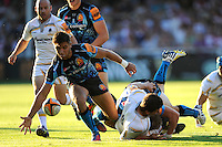 20130801 Copyright onEdition 2013 ©<br /> Free for editorial use image, please credit: onEdition.<br /> <br /> Rob Coote of Exeter Chiefs 7s mops up a loose ball during the J.P. Morgan Asset Management Premiership Rugby 7s Series.<br /> <br /> The J.P. Morgan Asset Management Premiership Rugby 7s Series kicks off for the fourth season on Thursday 1st August with Pool A at Kingsholm, Gloucester with Pool B being played at Franklin's Gardens, Northampton on Friday 2nd August, Pool C at Allianz Park, Saracens home ground, on Saturday 3rd August and the Final being played at The Recreation Ground, Bath on Friday 9th August. The innovative tournament, which involves all 12 Premiership Rugby clubs, offers a fantastic platform for some of the country's finest young athletes to be exposed to the excitement, pressures and skills required to compete at an elite level.<br /> <br /> The 12 Premiership Rugby clubs are divided into three groups for the tournament, with the winner and runner up of each regional event going through to the Final. There are six games each evening, with each match consisting of two 7 minute halves with a 2 minute break at half time.<br /> <br /> For additional images please go to: http://www.w-w-i.com/jp_morgan_premiership_sevens/<br /> <br /> For press contacts contact: Beth Begg at brandRapport on D: +44 (0)20 7932 5813 M: +44 (0)7900 88231 E: BBegg@brand-rapport.com<br /> <br /> If you require a higher resolution image or you have any other onEdition photographic enquiries, please contact onEdition on 0845 900 2 900 or email info@onEdition.com<br /> This image is copyright the onEdition 2013©.<br /> <br /> This image has been supplied by onEdition and must be credited onEdition. The author is asserting his full Moral rights in relation to the publication of this image. Rights for onward transmission of any image or file is not granted or implied. Changing or deleting Copyright information is illegal as specified in the Copyright, Design and Patents Act 1988. If you are in any way unsure of your right to publish this image please contact onE
