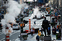 NEW YORK, NY - OCTOBER 20: People walk round Times Square on October 20, 2020 in New York, with more than a 72% decline in tourism activity since the spread of the pandemic. Hotels, restaurants, museums, are more affected across New York State.  (Photo by Eduardo MunozAlvarez/VIEWpress)