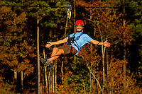 A man (model) enjoys the zip line sports at the US National Whitewater Center in Charlotte, NC. The USNWC, an ultimate adventure playground for outdoor enthusiasts, offers both water and land sports.