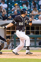 Jordan Danks (20) of the Charlotte Knights follows through on his swing against the Scranton/Wilkes-Barre RailRiders at BB&T Ballpark on July 17, 2014 in Charlotte, North Carolina.  The Knights defeated the RailRiders 9-5.  (Brian Westerholt/Four Seam Images)