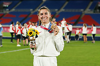 YOKOHAMA, JAPAN - AUGUST 6: Alex Morgan #13 of the United States poses with her bronze medal during the medal ceremony after a game between Canada and Sweden at International Stadium Yokohama on August 6, 2021 in Yokohama, Japan.