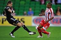 MELBOURNE, AUSTRALIA - JANUARY 09: Glen Moss of United  and Alex Terra of the Heart compete for the ball during the round 23 A-League match between the Melbourne Heart and Gold Coast United at AAMI Park on January 19, 2011 in Melbourne, Australia. (Photo by Sydney Low / Asterisk Images)