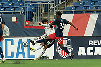 FOXBOROUGH, UNITED STATES - MAY 28: Dairon Reyes #26 of Fort Lauderdale CF passes the ball as Meny Silva #36 of New England Revolution II defends during a game between Fort Lauderdale CF and New England Revolution II at Gillette Stadium on May 28, 2021 in Foxborough, Massachusetts.