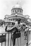 A pedestrin jumps a road divider in front of General Post Office in Kolkata, India.