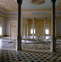 The first floor atrium of the Caliph's Kiosk in Istanbul features neo-Marmeluke columns and a central fountain surrounded by a floor of hexagonal blue and white tiles