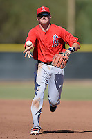 Los Angeles Angels second baseman Kody Eaves (21) flips the ball to first for an out during an Instructional League game against the Milwaukee Brewers on October 11, 2013 at Tempe Diablo Stadium Complex in Tempe, Arizona.  (Mike Janes/Four Seam Images)