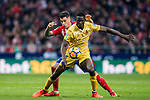 Michael Olunga Ogada (R) of Girona FC competes for the ball with Jose Maria Gimenez de Vargas of Atletico de Madrid  during the La Liga 2017-18 match between Atletico de Madrid and Girona FC at Wanda Metropolitano on 20 January 2018 in Madrid, Spain. Photo by Diego Gonzalez / Power Sport Images