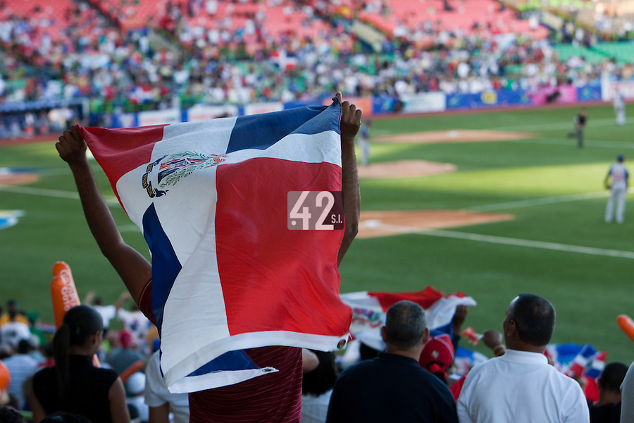 8 March 2009:  A fan waives the Dominican Republic flag during the 2009 World Baseball Classic Pool D match at Hiram Bithorn Stadium in San Juan, Puerto Rico. Dominican Republic wins 9-0 over Panama.