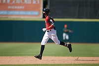 Pedro Gonzalez (4) of the Hickory Crawdads rounds the bases after hitting a home run during the game against the Greensboro Grasshoppers at L.P. Frans Stadium on May 26, 2019 in Hickory, North Carolina. The Crawdads defeated the Grasshoppers 10-8. (Brian Westerholt/Four Seam Images)