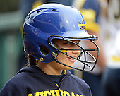 Michigan Wolverines bat girl during the season opener against the Florida Gators on February 8, 2014 at the USF Softball Stadium in Tampa, Florida.  Florida defeated Michigan 9-4 in extra innings.  (Copyright Mike Janes Photography)