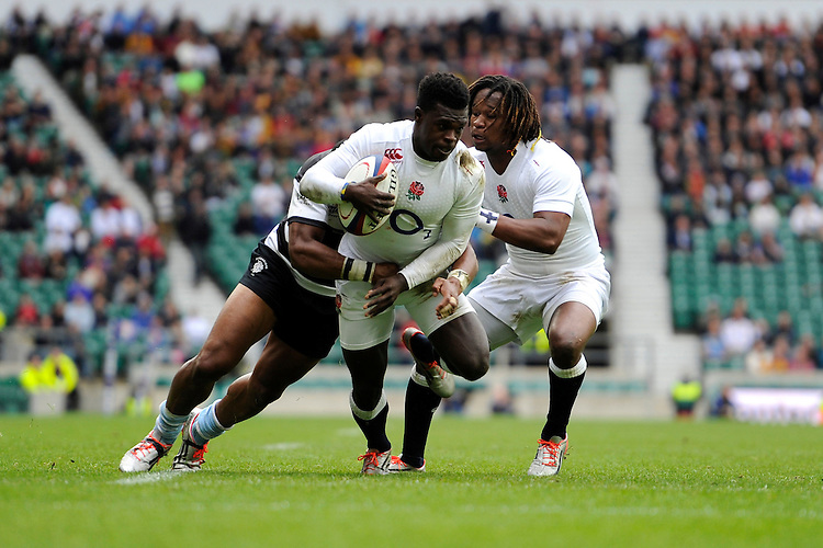 Christian Wade of England is tackled by Joe Rokocoko of Barbarians as Marland Yarde of England supports during the match between England and Barbarians at Twickenham Stadium on Sunday 31st May 2015 (Photo by Rob Munro)