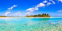 Paradisiac motu with coconut palm trees and white sand, on turquoise Tikehau atoll lagoon in the Tuamotus, French Polynesia, South Pacific Ocean