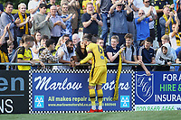 Louis John of Sutton United celebrates with a kiss at the end of the match during Sutton United vs Stevenage, Sky Bet EFL League 2 Football at the VBS Community Stadium on 11th September 2021