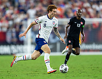 NASHVILLE, TN - SEPTEMBER 5: Josh Sargent #9 of the United States dribbles during a game between Canada and USMNT at Nissan Stadium on September 5, 2021 in Nashville, Tennessee.