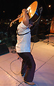 """voz-FoodCityFiestas0919 091407 A member of """"Los Nenes de Sonra (cq) performs at the Food City Fiestas Patrias in Phoenix, on Friday, Sept. 14, 2007.  Photo by AJ Alexander/La Voz"""