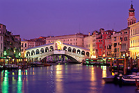 Italy, Venice. The Grand canal with the Rialto Bridge at dusk