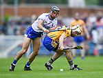 Shane Fives of Waterford  in action against Conor Mc Grath of Clare during their Munster  championship round robin game at Cusack Park Photograph by John Kelly.