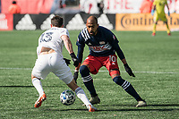 FOXBOROUGH, MA - MARCH 7: Brandt Bronico #13 of Chicago Fire changes direction to avoid Teal Bunbury #10 of New England Revolution during a game between Chicago Fire and New England Revolution at Gillette Stadium on March 7, 2020 in Foxborough, Massachusetts.