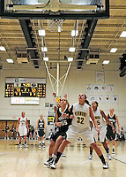 5 December 2009: University of Vermont Catamount forward/center Lauren Buschmann (32), a Freshman from St. Catharines, Ontario, looks to get a foul shot rebound against the Manhattan College Jaspers at Patrick Gymnasium in Burlington, Vermont. The Catamounts defeated the visiting Jaspers 78-59 to mark the Lady Cats' second home win of the season. Mandatory Credit: Ed Wolfstein Photo