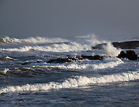Springtime storms bring waves rolling onto the rugged rocky coast at Pescadero State Beach on California's coast.
