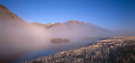 Mist and fog over a small lake in the Ahuriri Valley in Canterbury. New Zealand.