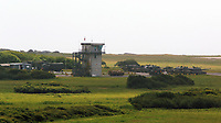 Thursday 15 June 2017<br /> Pictured: Tanks and a tower in Castlemartin range.<br /> Re: A soldier has been killed and three others injured after an incident involving a tank at a Ministry of Defence base in Pembrokeshire.<br /> The soldier, from the Royal Tank Regiment, died in the incident at Castlemartin Range.<br /> Two people were taken to Morriston Hospital in Swansea, while another casualty remains in Cardiff's University Hospital of Wales.<br /> An investigation is under way.<br /> Live firing was scheduled to take place at the range between Monday and Friday.<br /> In May 2012, Ranger Michael Maguire died during a live firing exercise at the training base. An inquest later found he was unlawfully killed.