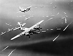 Marauders of the 9th Air Force bombardment group, fly over units of the Allied fleet as they approach landfall on the French coast, on June 21, 1944. Marauder groups such as these, fly constantly in close support of our advancing group forces. Their targets are enemy gun positions, bridges, railroad and highway junctions, convoys and troops concentrations. (AP Photo)
