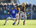 Barry Coote of Ballyea in action against Podge Collins of  Cratloe during the county senior hurling final at Cusack Park. Photograph by John Kelly.
