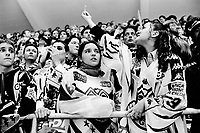 """Switzerland. Canton Ticino. Lugano. Resega ice rink. Final hockey game for the title of swiss championship. Lugano loses the game in overtime and the supporters are upset. A young woman is making an obscene gesture showing her middle finger """"Fuck off """" to the fans of the winning team. In Western culture, the finger or the middle finger (as in giving someone the (middle) finger, is an obscene hand gesture. The gesture communicates moderate to extreme contempt, and is roughly equivalent in meaning to """"fuck off"""", """"fuck you,"""" """"shove it up your ass/arse,"""" """"up yours,"""" or """"go fuck yourself."""" It is performed by showing the back of a hand that has only the middle finger extended upwards. © 2001 Didier Ruef"""