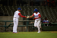 Stockton Ports designated hitter Melvin Mercedes (37) is congratulated by manager Rick Magnante (7) after hitting a home run during a California League game against the Rancho Cucamonga Quakes at Banner Island Ballpark on May 16, 2018 in Stockton, California. Rancho Cucamonga defeated Stockton 6-3. (Zachary Lucy/Four Seam Images)