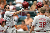 Outfielder Max White #7 of the Oklahoma Sooners is greeted by his team following his home run against the Texas Longhorns in NCAA Big XII baseball on May 1, 2011 at Disch Falk Field in Austin, Texas. (Photo by Andrew Woolley / Four Seam Images)