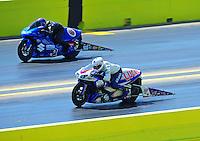 Sept. 25, 2011; Ennis, TX, USA: NHRA pro stock motorcycle rider Hector Arana Jr (near lane) races alongside Jim Underdahl during the Fall Nationals at the Texas Motorplex. Mandatory Credit: Mark J. Rebilas-