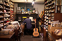 Spain - Barcelona - A pianist plays inside the charming Casa Beethoven, a music store located in the heart of the Ciudad Vella since 1880.