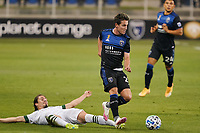 SAN JOSE, CA - SEPTEMBER 19: Carlos Fierro #21 of the San Jose Earthquakes avoids the tackle of Jorge Villafana #4 of the Portland Timbers during a game between Portland Timbers and San Jose Earthquakes at Earthquakes Stadium on September 19, 2020 in San Jose, California.