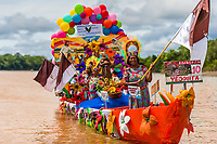 Afro-Colombian dancers of the La Yesquita neighborhood travel the Atrato river in a colorfully adorned boat during the San Pacho festival in Quibdó, Colombia, 3 October 2019. Every year at the turn of September and October, the capital of the Pacific region of Chocó holds the celebrations in honor of Saint Francis of Assisi (locally named as San Pacho), recognized as Intangible Cultural Heritage by UNESCO. Each day carnival groups, wearing bright colorful costumes and representing each neighborhood, dance throughout the city, supported by brass bands playing live music. The festival culminates in a traditional boat ride on the Atrato River, followed by massive religious processions, which accent the pillars of Afro-Colombian's identity – the Catholic devotion grown from African roots.