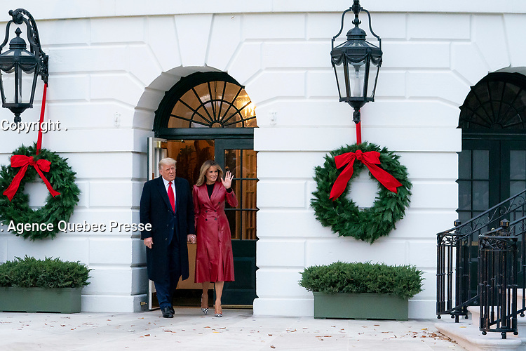 President Trump and the First Lady Depart for Florida<br /> <br /> President Donald J. Trump and First Lady Melania Trump wave to guests and members of the press as they depart the South Portico entrance of the White House Saturday, Dec. 5, 2020, before boarding Marine One on the South Lawn to begin their trip to Georgia. (Official White House Photo by Tia Dufour)