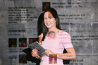NO Repro Fee.27/10/2010.  Ballygowan Pink's B Part Of It campaign in support of Breast Cancer Awareness Month. Hundreds of UCD students got behind Ballygowan Pink's B Part Of It campaign in support of Breast Cancer Awareness Month. Pictured is Regina Brady from Longford who posted messages of support to the life-sized Facebook Wall which was projected onto the entrance of UCD library. A live stream of students' messages was seen throughout the day to raise awareness of breast cancer and support the Marie Keating Foundation. Picture James Horan/Collins Photos
