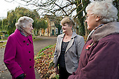 """Three elderly women wait for a CallConnect bus in the village of Ewerby, Lincolnshire.  The innovative bus-on-demand service features in the Rural Media Company's """"Over the Hill?"""" project."""