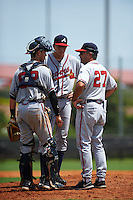GCL Braves pitching coach Mike Alvarez (27) talks with catcher Collin Yelich (61) and pitcher Evertz Orozco (33) during a game against the GCL Astros on July 23, 2015 at the Osceola County Stadium Complex in Kissimmee, Florida.  GCL Braves defeated GCL Astros 4-2.  (Mike Janes/Four Seam Images)