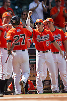 Sam Houston State Bearkats outfielder Travis Lee #5 greets teammate Ryan O'Hearn #27 after he blasted a home run in the NCAA baseball game against the Texas Tech Red Raiders on March 1, 2014 during the Houston College Classic at Minute Maid Park in Houston, Texas. The Bearkats defeated the Red Raiders 10-6. (Andrew Woolley/Four Seam Images)